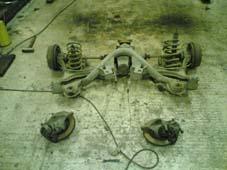 Spindler, drivverk og bakhjulsoppheng av.